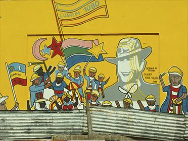 Homenaje Al Barrio. Mural De Carlos Paez Vilaró En La Plaza Medellín. Montevideo, Carlos Gardel Y Curuguaty. Foto: Olga Picún.